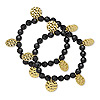 Bracelet, stretch, acrylic and gold-finished pewter (tin-based alloy), black, 6-8mm faceted round and 10-15mm dimpled flat round, 7-1/2 inches. Sold per pkg of 2. Minimum 8 per order.
